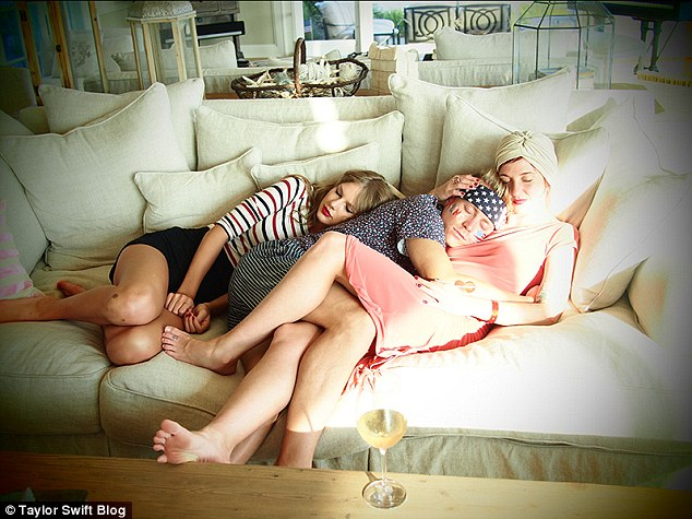 Cuddle puddle: Taylor captioned this cuddly couch shot as 'Nap time with Scott and Caitlin'