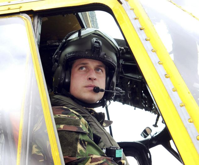 Royal rescue: The prince, Flt Lt Wales, was at the controls of the helicopter that winched injured climber Nathan Wright to safety