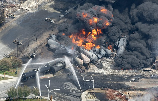 Scorched: Burnt out cars and rubble can be seen as the railway cars continue to burn