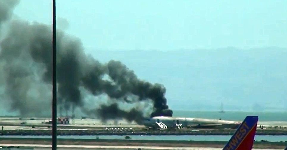 Crash landing: The plane pictured on the runway at San Francisco airport