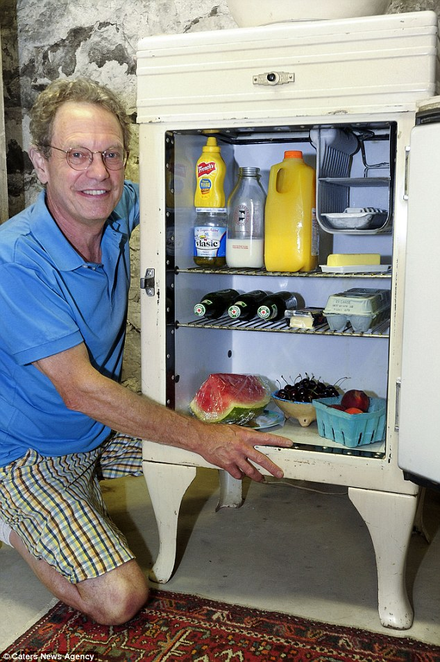 Cooler than cool: Owner Mark Vail showing off his vintage fridge