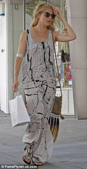 Stylish: Sienna headed out to the shops to stock up on children's clothing for her daughter Marlowe as her one year birthday approaches