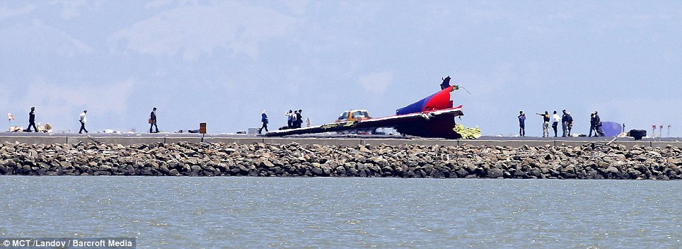 Investigators work at the scene of the Asiana Airlines Flight 214 crash site at San Francisco International Airport on July 7th, 2013, in San Francisco, California