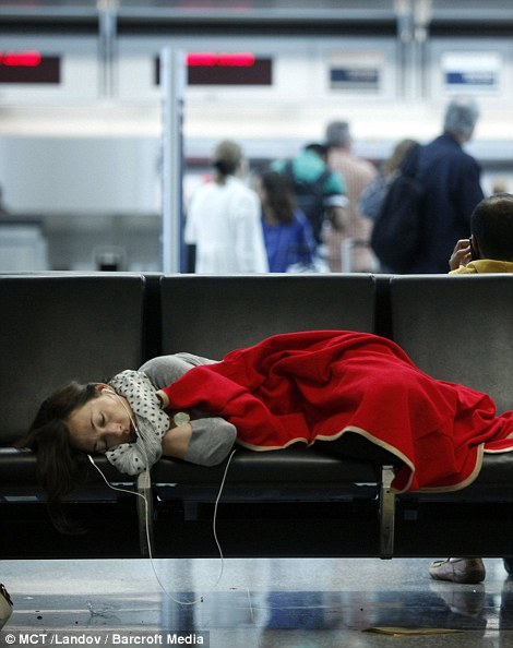 Stranded passengers sleep in the International Terminal at San Francisco International Airport on July 7, 2013, in San Francisco, California