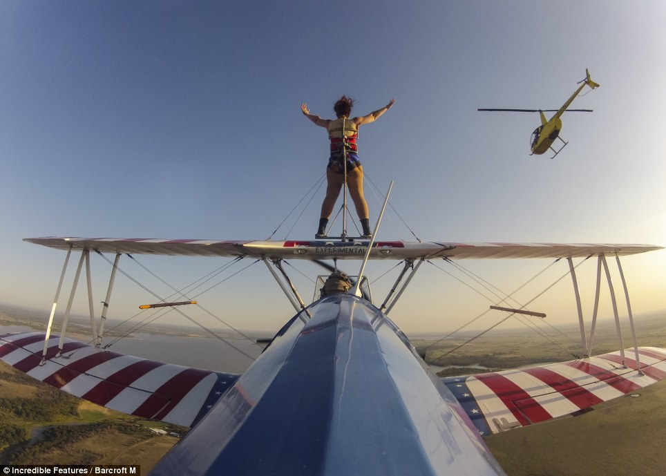 High flyer: Ashley has clocked up over 100 flights in her career and is part of an all-female wing walkers crew who share a love for thrills and high altitudes