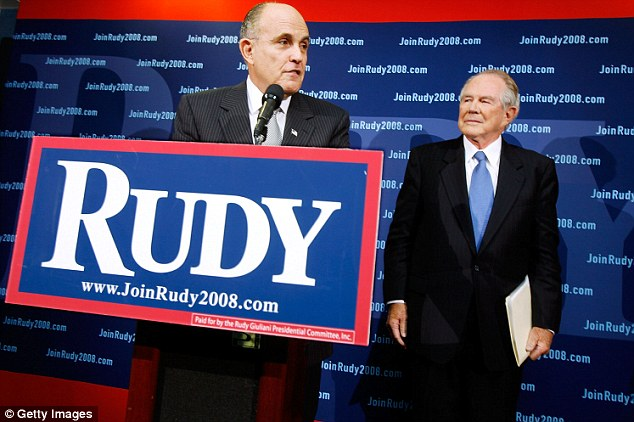 Conservative evangelical leader Pat Robertson (right) announces his endorsement of former New York City Mayor Rudy Giuliani for the Republican presidential nomination at the National Press Club November 7, 2007 in Washington D.C.