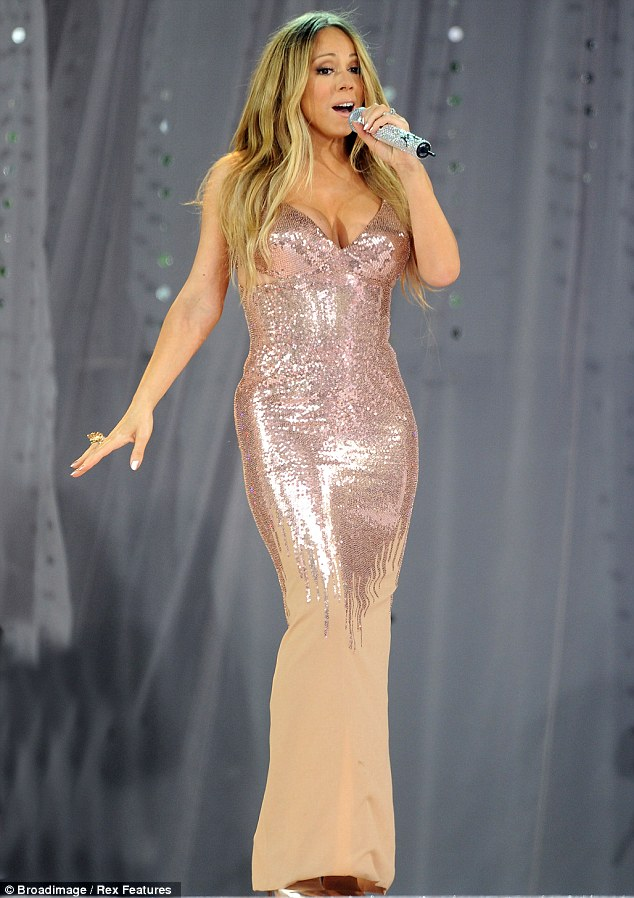 On-set mishap: Mariah Carey is 'fine' after she was rushed to hospital with a dislocated shoulder on Sunday night following an accident while filming her new music video in New York
