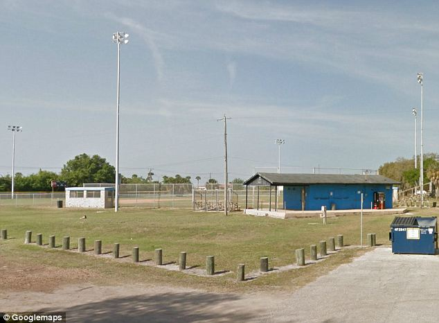 Low tech: By dragging a trash can from a softball field (pictured) near the base's walls, Jensen said she was able to climb into MacDill when she broke in the second. The homeless woman was warned again to leave and not come back