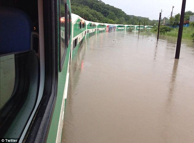 Looking out: The train carriages were completely surrounded by flood water