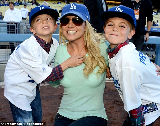 Doting mother: Britney poses with her boys at a San Diego Padres v Los Angeles Dodgers baseball game in Los Angeles back in April