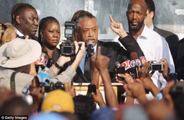 Rev. Al Sharpton (C) spoke at a 'Justice for Trayvon' rally along with Tracy Martin (R) and Sybrina Fulton (2nd L), parents of slain teenager Trayvon Martin, on March 22, 2012