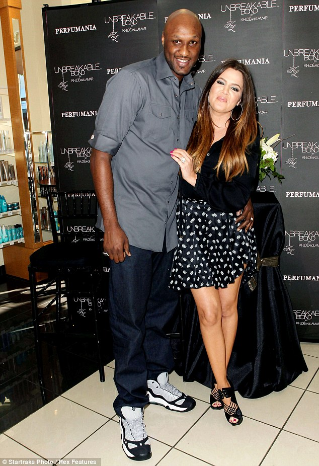 Trouble in paradise? Khloe is standing by her man despite allegations that he has had a year-long affair