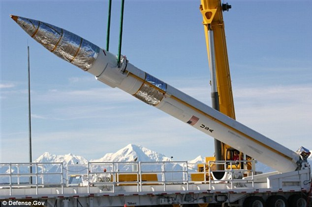 First Line Of Defense: A ground-based missile interceptor is lowered into its missile silo at the Missile Defense Complex at Fort Greely, Alaska. Eighteen interceptors are emplaced in two fields on the 800-acre complex