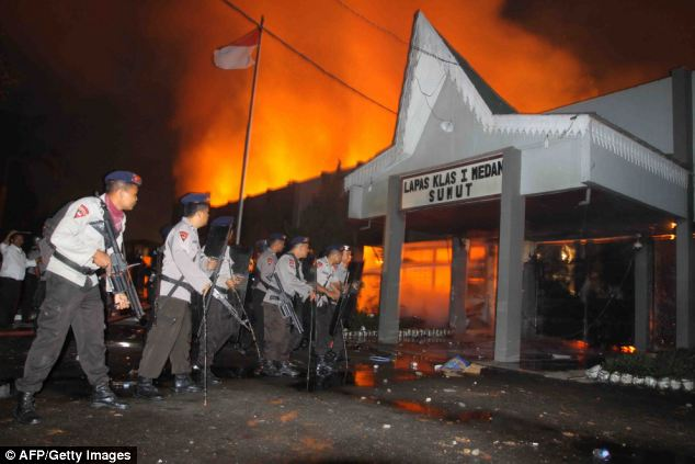 About 200 inmates escaped in the riot with dozens still on the run the following day