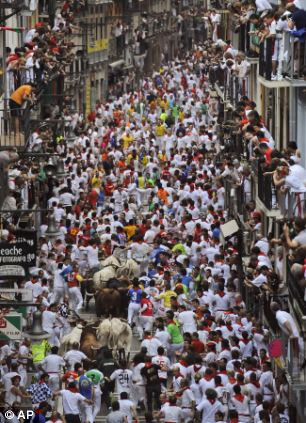 Runners make their way through the streets with
