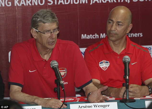 Staying put: Arsene Wenger (left) will stay at Arsenal after admitting talks over a new deal have begun