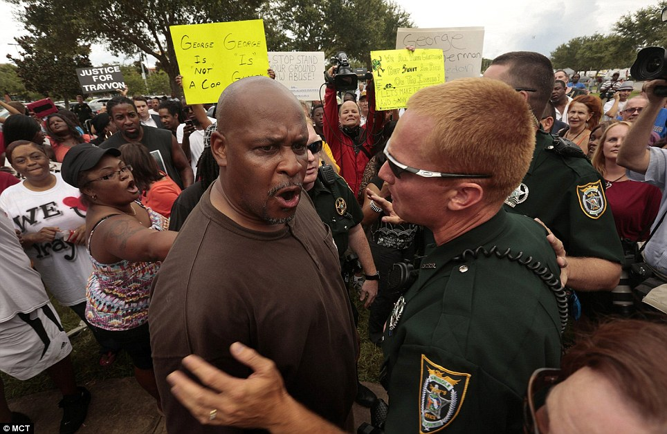 A demonstrator cries after hearing th not guilty verdict in the trial of George Zimmerman at the Seminole County Criminal Justice Center in Sanford, Florida