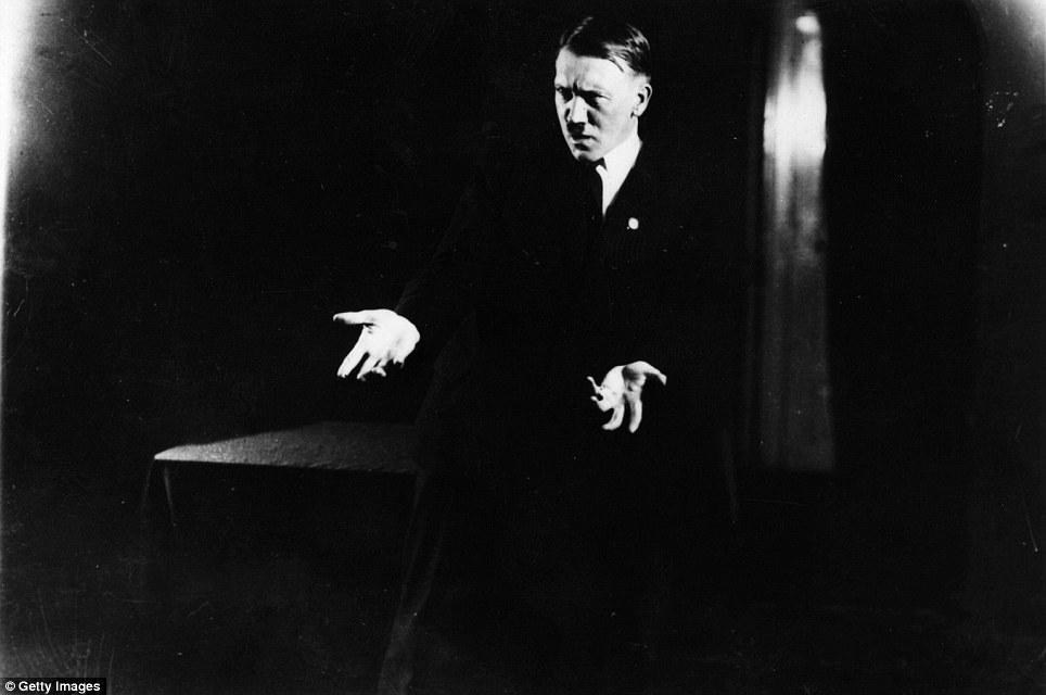 Hitler strikes a poses as a rehearses his rhetoric for the camera