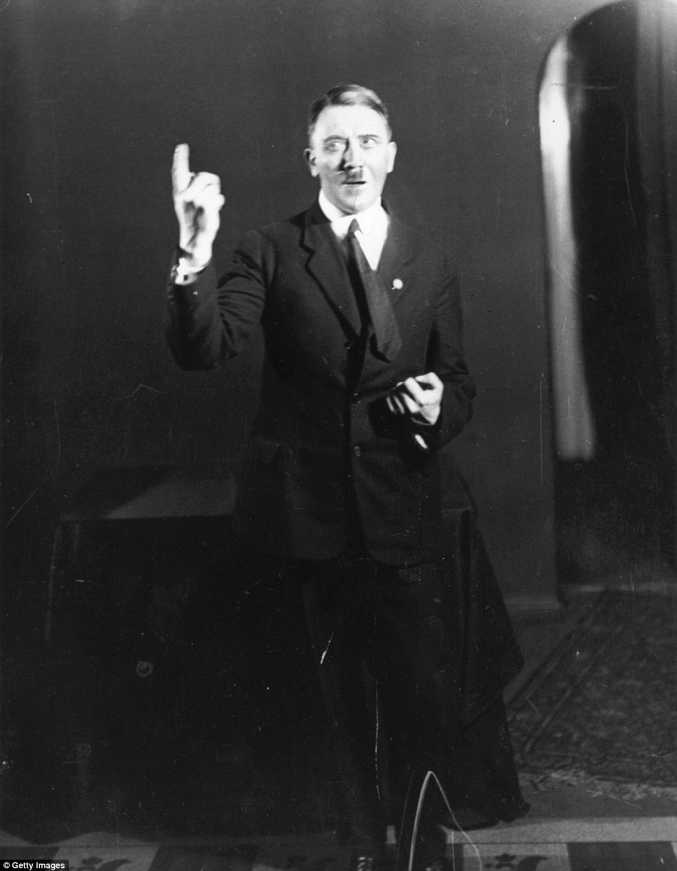 With an intense gaze, Hitler makes a point to an imaginary audience as he rehearses a speech