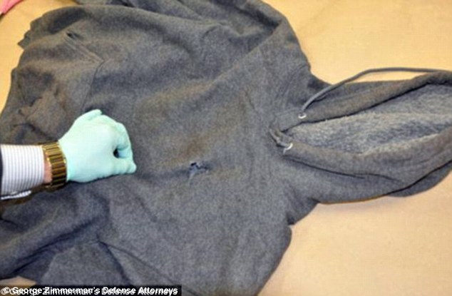 Fatal mark: A bullet hole can be seen in the front of the hooded top Trayvon was wearing on the night he died