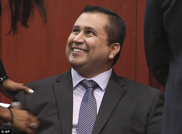 Relief: George Zimmerman breaks into a smile of relief a few moments after being cleared of all charges