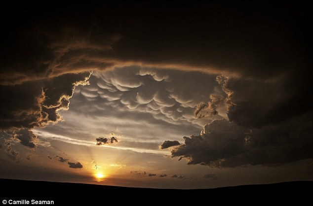 Eye catching: Odd shaped clouds frame the Sun