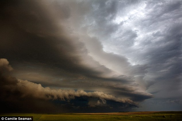 Chase: A supercell races across the flat expanse of land