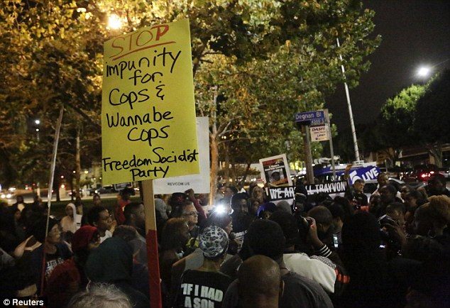 Rally: Protesters in Los Angeles gather to show their response to the Zimmerman trial on Saturday night as demonstrations spread across the country