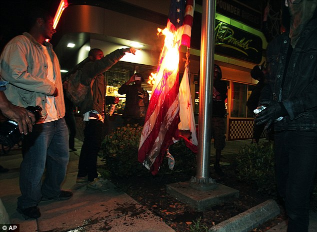 Demonstrators also burned an American flag to show their displeasure with the jury verdict, which saw Zimmerman go free