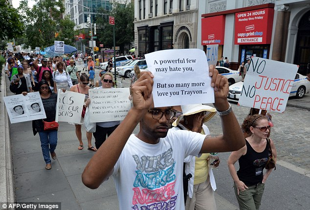 A man holds a placard at the Union Square rally