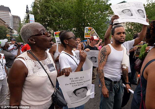 People march during a demonstration at Union Square in New York on July 14, 2013