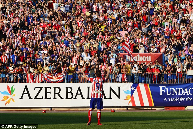 Popular choice: Atletico fans packed out the Vicente Calderon Stadium to see their new signing