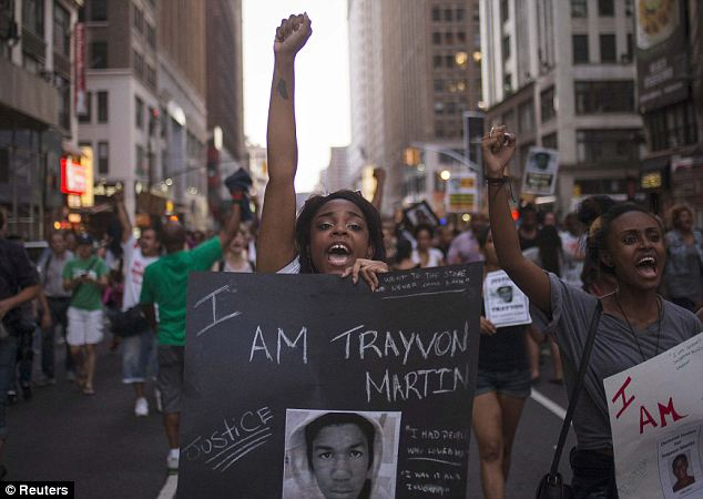 Justice: Protestors scream a call for justice in the memory of slain teen Trayvon Martin during a July 14 march from Manhattan's Union Square to Times Square