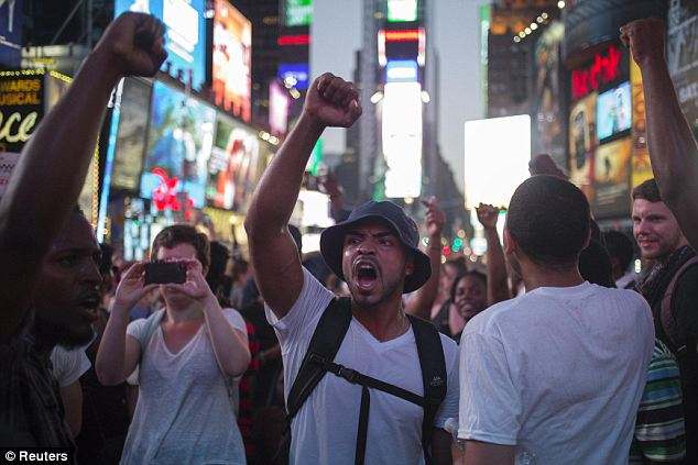 Fever pitch: Activists demand justice for Trayvon Martin after marching to Times Square from New York's Union Square July 14. The march continued uptown toward Harlem as tensions mounted and arrests began