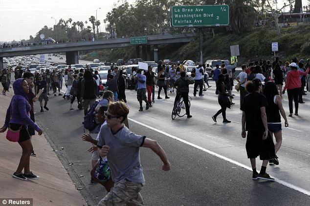 Blocked: With emotions high and traffic stopped, tensions rose as protestors blocked the Los Angeles freeway
