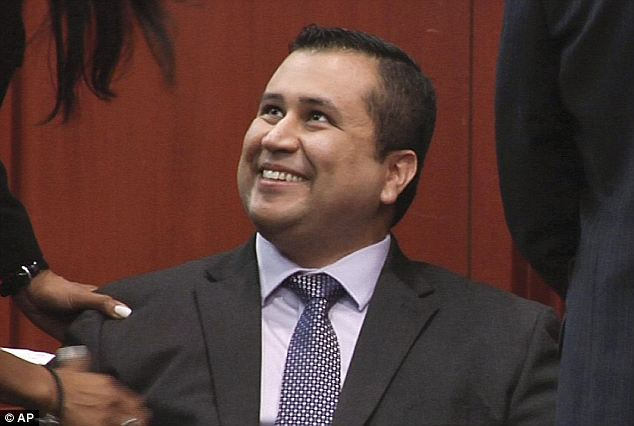 Celebrations: George Zimmerman smiles after being found not guilty of the murder or manslaughter of Trayvon Martin. The identities of the jury who made that decision remain secret