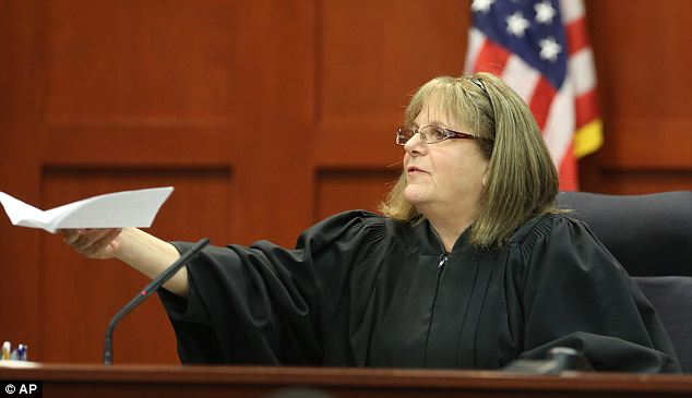 Ruling: Judge Debra Nelson hands the verdict to the clerk of courts announcing George Zimmerman is not guilty, at the Seminole Circuit Court on July 13, 2013. Judge Nelson ruled that the jurors must remain anonymous