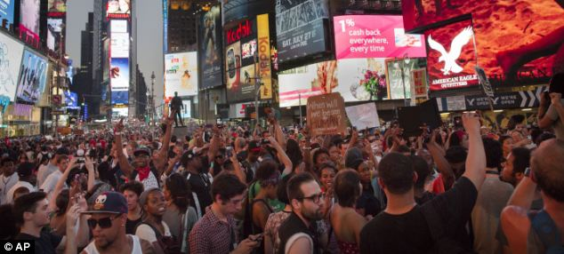 Demonstrators massed in Times Square Saturday night after a march against Zimmerman's acquittal. Most of the protests nationwide were peaceful