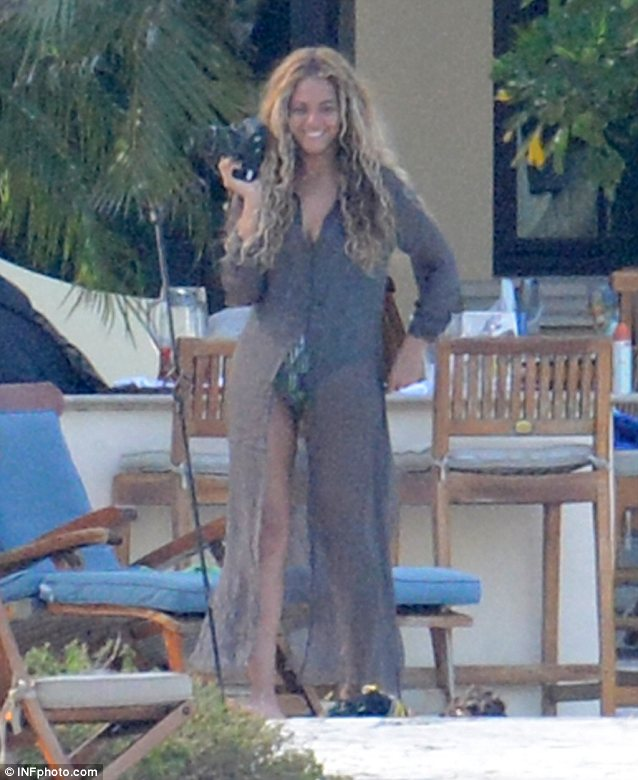 Camerawoman: Beyoncé takes some fun snaps of her daughter by the pool
