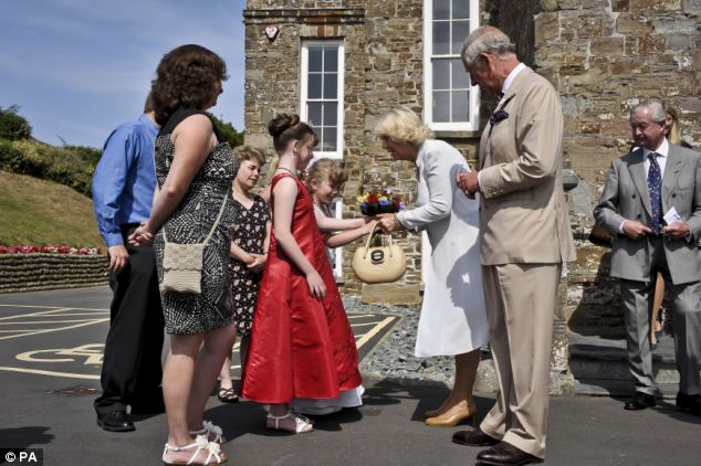 Honour: The couple were presented with flowers by Fairy Queen Amber Clay and Fairy Princess Emily Hardy, both aged 10