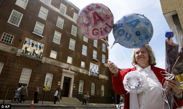 Hedging her bets: Royal supporter Margaret Tyler is waiting for news of the birth before choosing which balloon she will wave