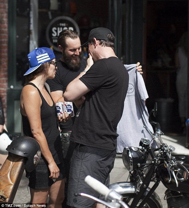Surrounded by temptation: Monteith (R) allegedly returned to his hard-partying ways in his native Vancouver, pictured with beer in the city earlier this month