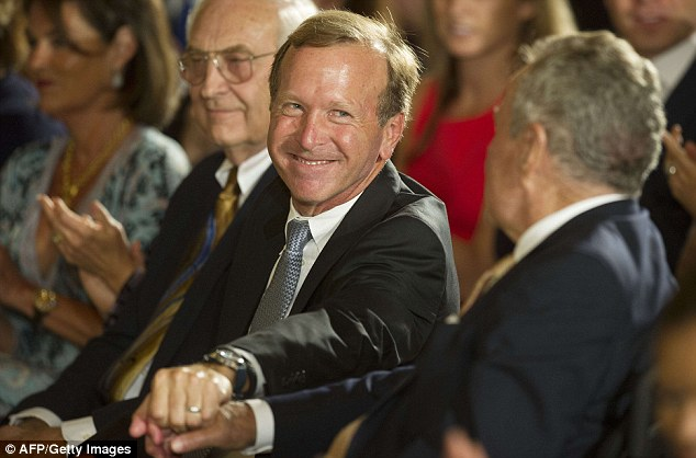 Savior: Son of former US President George H.W. Bush, Neil Bush (center), rescued the stranded group in Maine