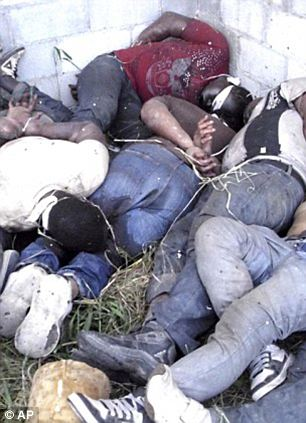 Shocking: Bodies of some of the victims were found piled on top of each other after the massacre