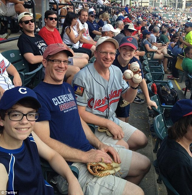 Lucky streak: Greg Van Niel, pictured with his brother and nephews and three of his four foul balls