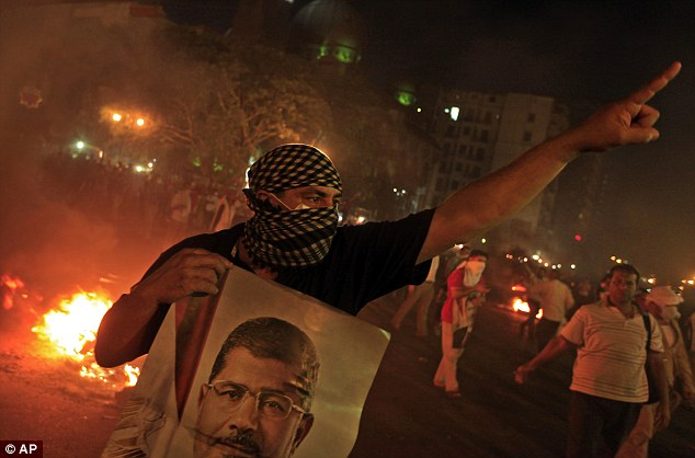 Protest: Supporters of ousted President Mohammed Morsi held mass rallies, blocked main river crossings and marched in the streets to demand his return to office