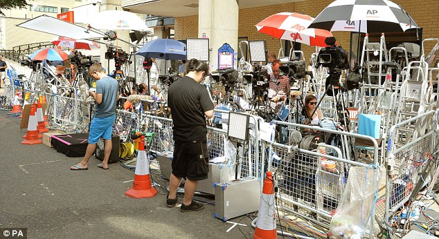 News teams from across the globe have set up chairs, ladders and umbrellas in their makeshift camp as they await word of the duchess's arrival