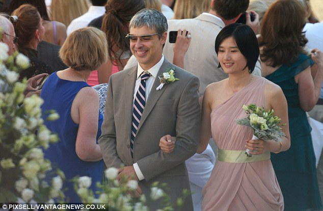 All eyes on you: Google co-founder and groomsman Larry Page accompanies a bridesmaid down the aisle at his brother's wedding in Croatia