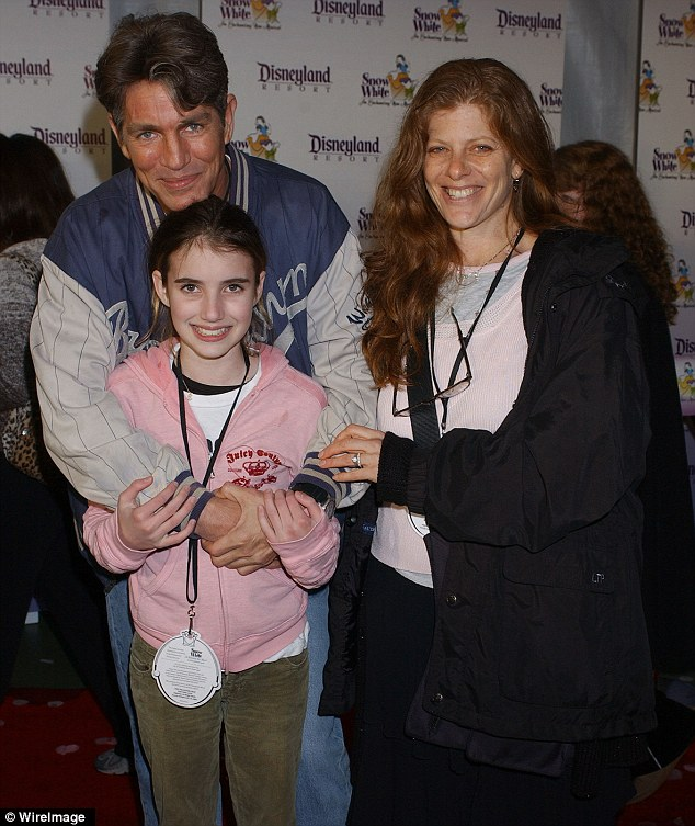 Family photo: Eric Roberts posed for a photo with his daughter Emma and wife Eliza during a trip to Disneyland in February 2004