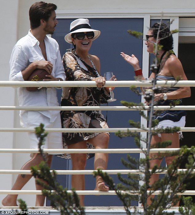 Baby's first outing: It is believed that Kim brought the baby to Bruce Jenner's Malibu beach house on the Fourth of July. Scott Disick and Kris Jenner are seen here on the occasion